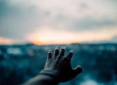 Hand Reaching For The Horizon
