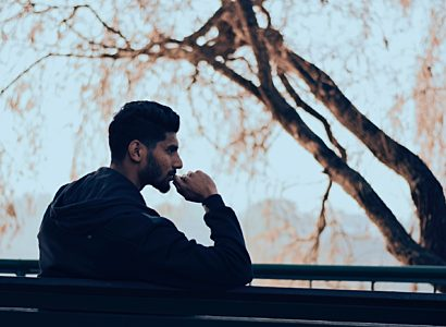 Man on bench thinking