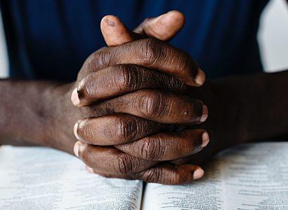 Man Praying With The Bible