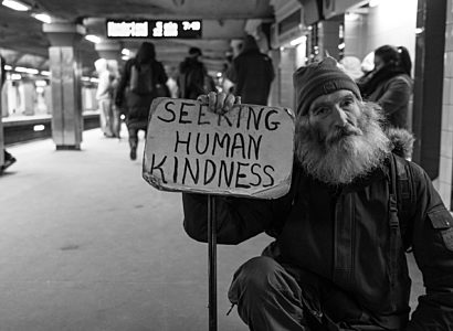 Man With Sign Asking For Human Kindness