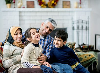 Refugee family laughing