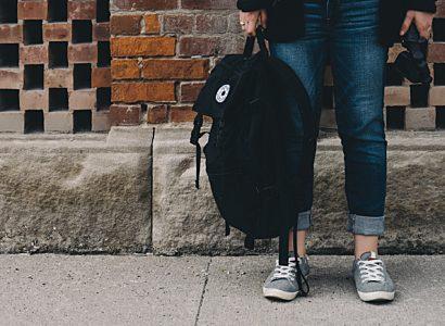 Teenager Standing Near A Brick Wall