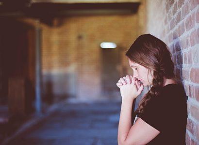 Woman praying in chapel