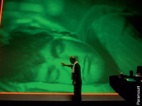 The god-like Christof (Ed Harris) watches over his subject (Jim Carrey) in The Truman Show