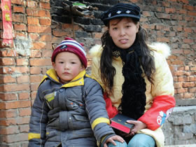 This is the first Bible for Zhang, 28, and her son Wang, 4